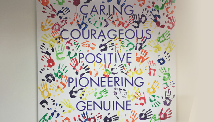 Picture of the hospice's values saying, Caring, Courageous, Positive, Pioneering, Genuine